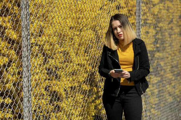 Isabelle Serrano, a senior at New York University, at Union High School in Union, N.J., March 26, 2020. As the economy barrels toward a recession, college seniors like Serrano fear they could become the next class of 2009, which entered the work force at the peak of the Great Recession as companies conducted mass layoffs and froze hiring. (Ben Solomon/The New York Times)