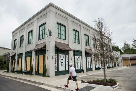 The building housing Rosie Cannonball and the Monrose Cheese & Wine is boarded up and closed on Saturday, March 28, 2020 in Houston. Businesses around the city have been closed and boarded up due to the coronavirus pandemic precautions, forcing several businesses to shut their doors.