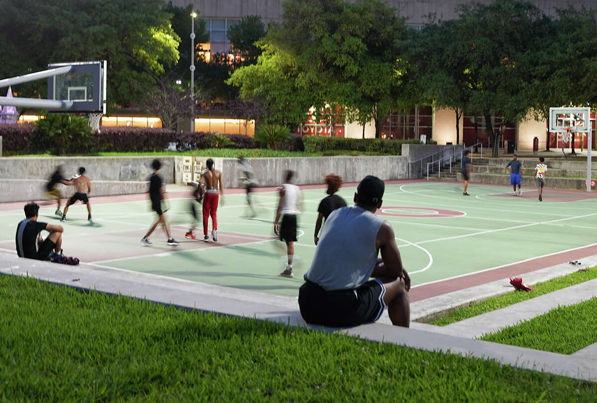 Basketball games still continue at Root Square park in downtown Houston despite Harris County's stay at home policy on Friday, March 27, 2020.