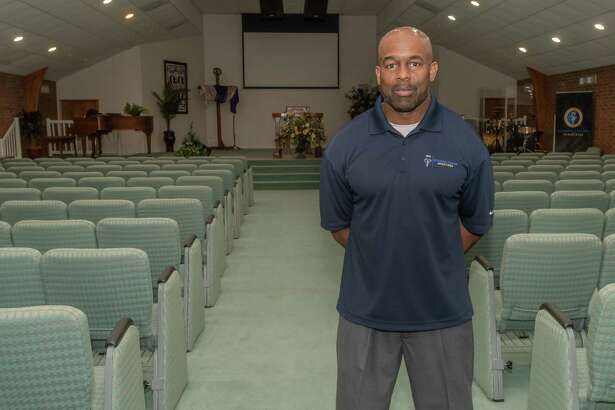 Pastor Herb Fontnette stands in the sanctuary of Strong Tower Ministries Church in Port Arthur. In a news conference, Mayor Thurman Bill Bartie mentioned some churches in the city were still open for services. Photo made on March 28, 2020. Fran Ruchalski/The Enterprise