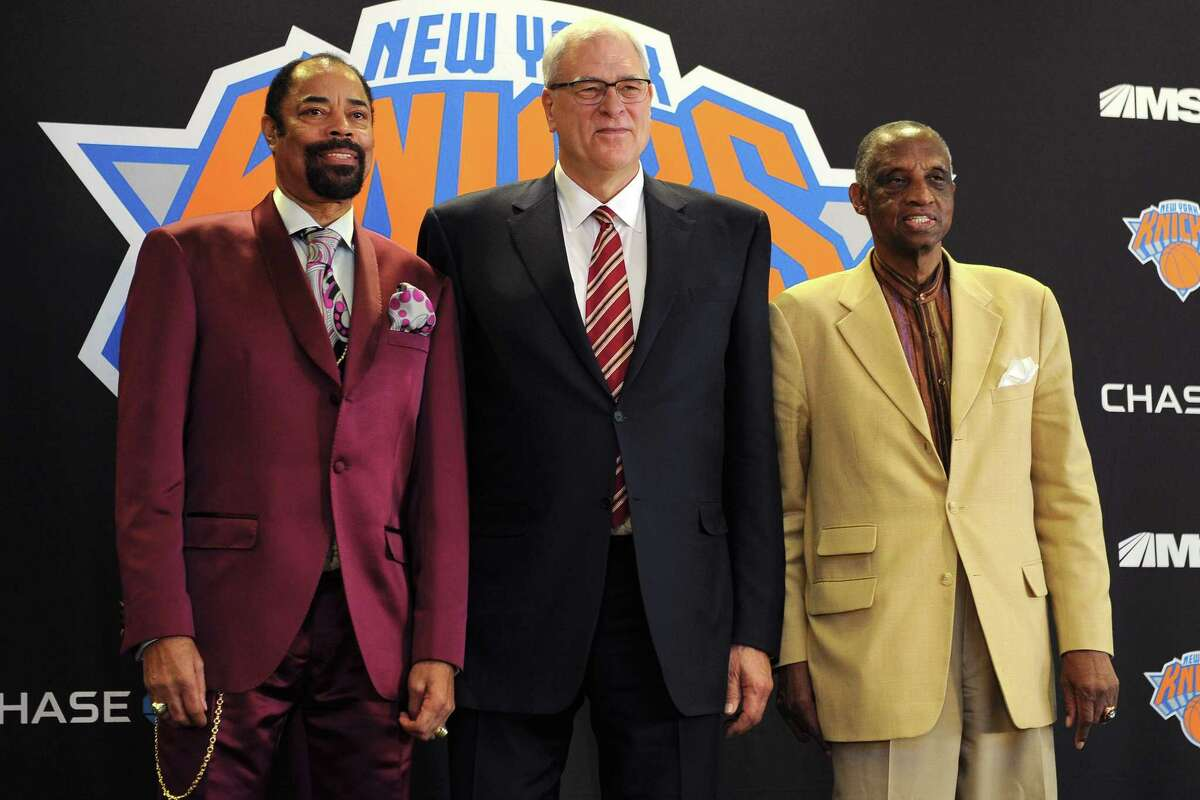 FILE - JUNE 28, 2017: It has been reported that the New York Knicks and team president Phil Jackson have agreed to part ways. Jackson was team president for three years. NEW YORK, NY - MARCH 18: (L to R) Walt Frazier, Phil Jackson, and Dick Barnett, ex-teammates on the New York Knicks, stand for a photo during during the press conference to intrduce Jackson as the President of the Knicks at Madison Square Garden on March 18, 2014 in New York City. (Photo by Maddie Meyer/Getty Images) ORG XMIT: 479324037