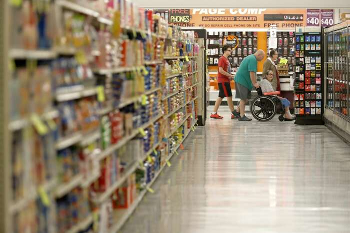 Shoppers take part in at Food Town's elderly-only hour, Wednesday, March 18, 2020, in New Caney. The grocery store established an elderly-only hour for shoppers 65-years or older from 7 a.m. to 8 a.m.