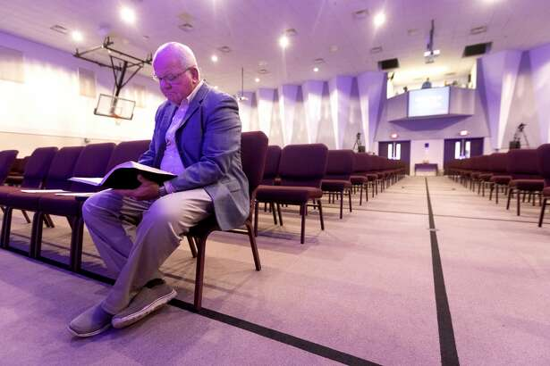 Senior Pastor Jay Gross looks over his sermon before streaming a worship service at West Conroe Baptist Church, Sunday, March 15, 2020, in Conroe. The church, like many in the region, closed in-house services for parishioners after a disaster declaration was issued for Montgomery County, limiting public gatherings of 250 people or more because of the coronavirus. Many churches opted to stream services online for the safety of parishioners.
