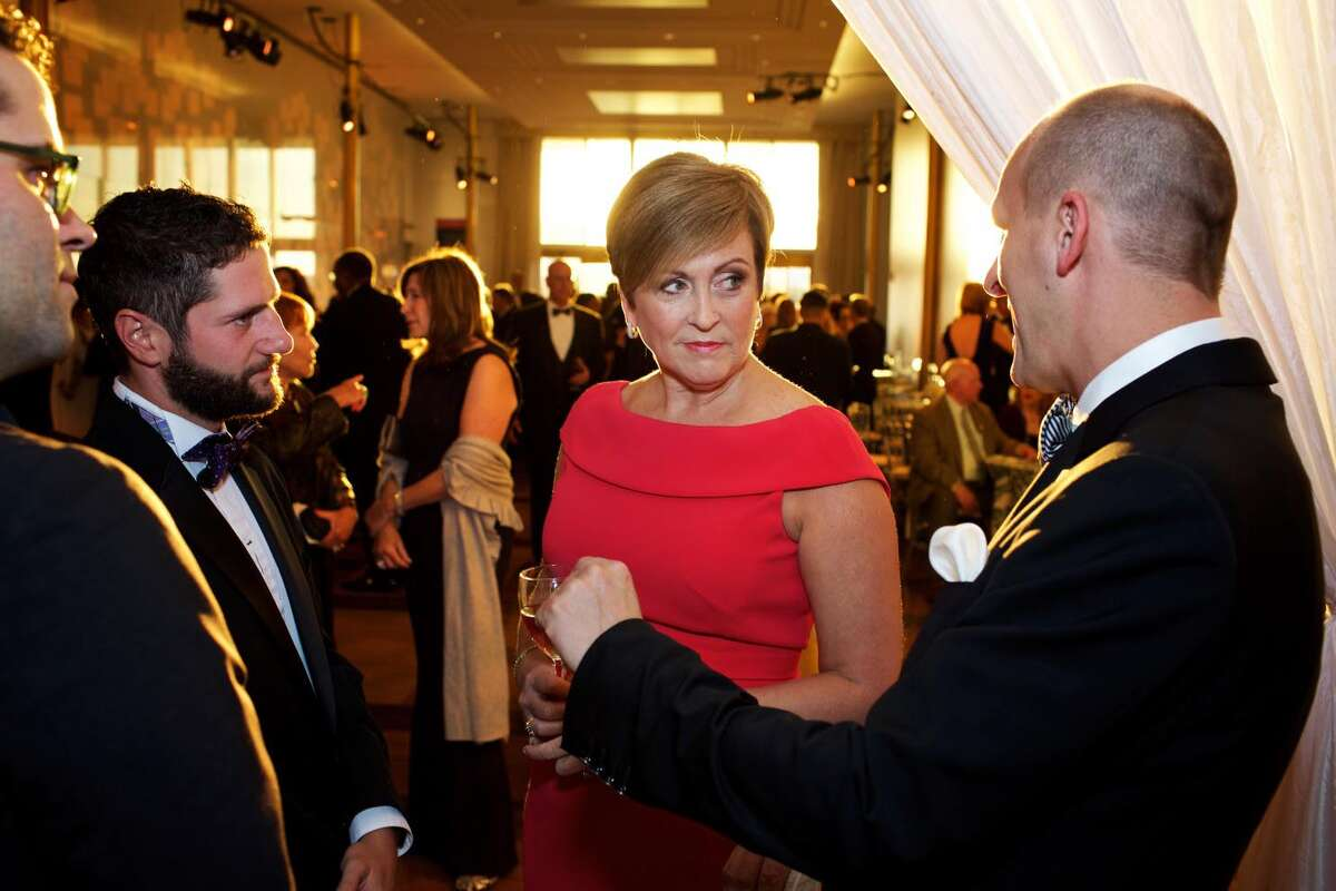 Kennedy Center President Deborah Rutter speaks to producer Robert Pullen, right, at an NSO gala in 2016. MUST CREDIT: Photo by Deb Lindsey for The Washington Post.