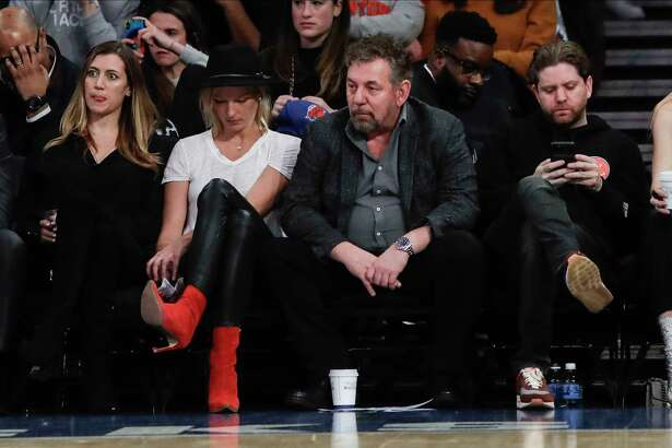 New York Knicks owner James Dolan, center, reacts with fans during the second half of the team's NBA basketball game against the Memphis Grizzlies on Wednesday, Jan. 29, 2020, in New York. The Grizzlies won 127-106.