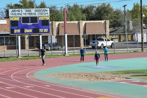 Midlanders get outside Saturday, March 28, 2020 at Midland High School tack. Jacy Lewis/Reporter-Telegram