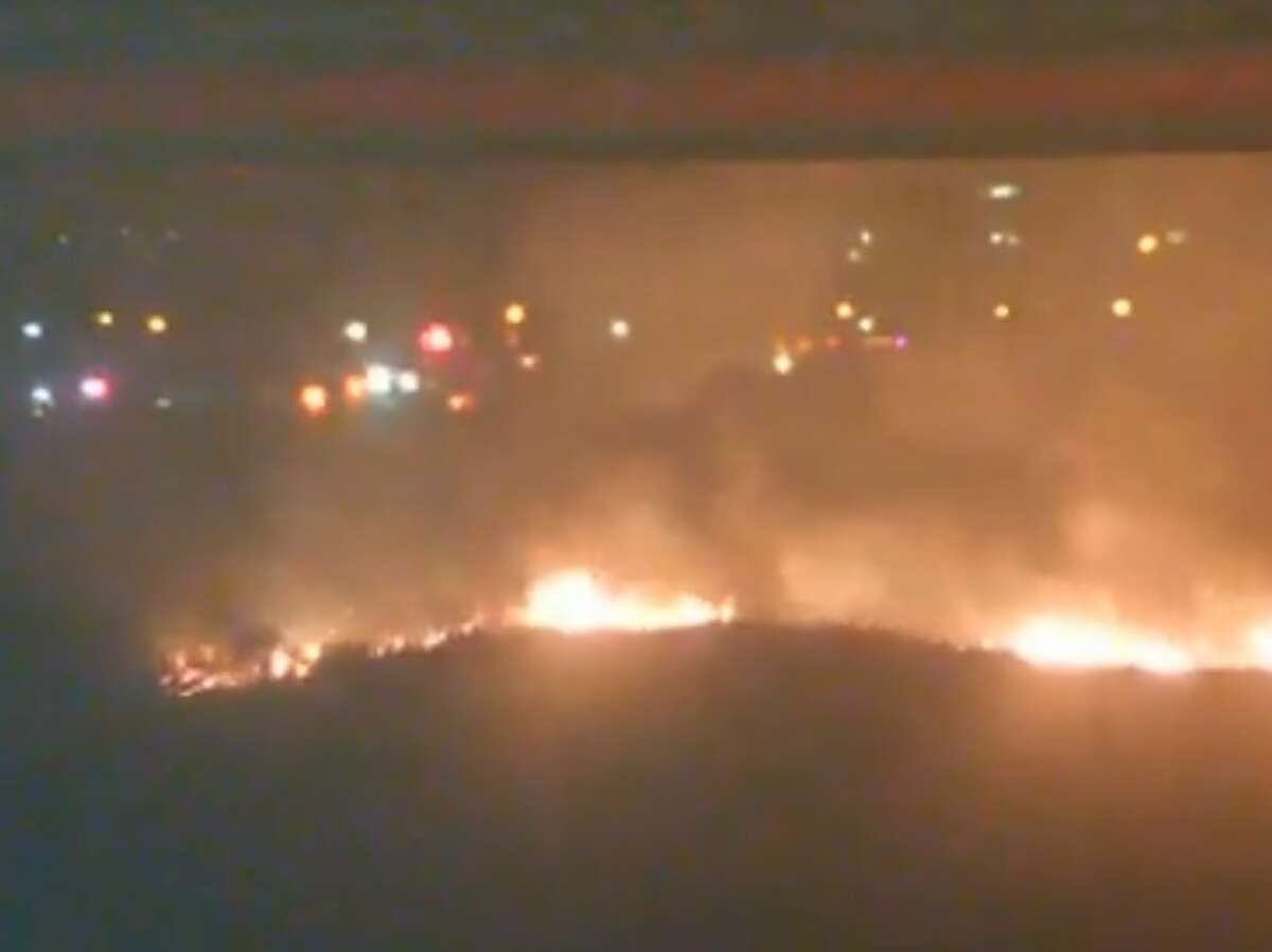Cameras from the Galveston webcam operator Saltwater Recon are broadcasting live images of the firefighters battling the blaze.