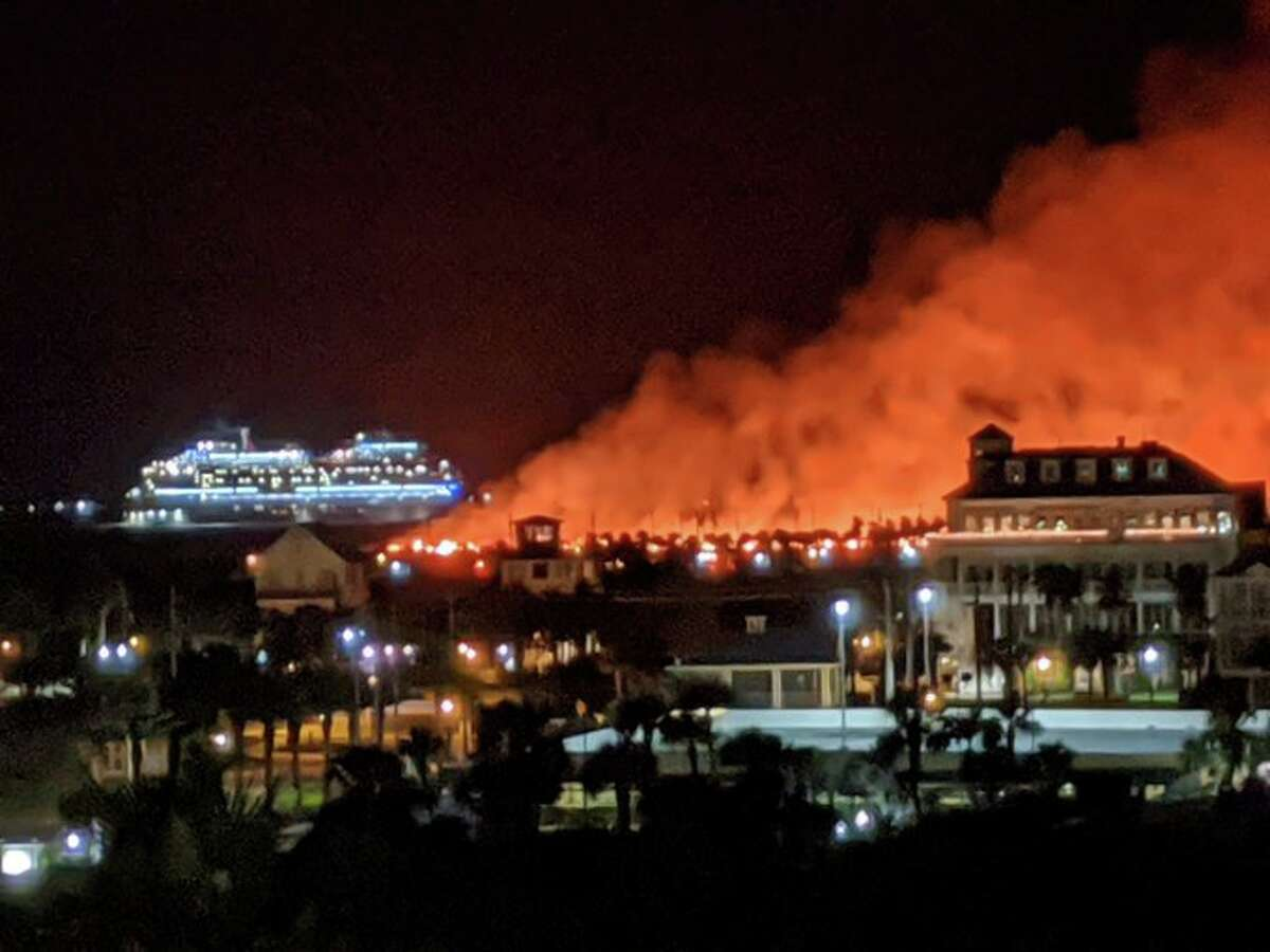 Firefighters are battling a fire on the eastern tip of Galveston Island.