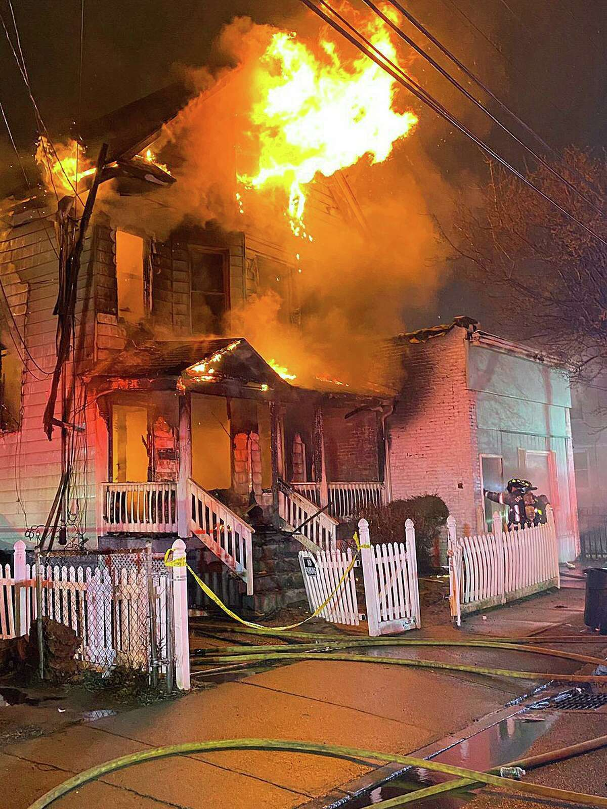 Five people escaped unharmed after a fire tore through a building in the the 1000th block of Stratford Avenue early Sunday morning.