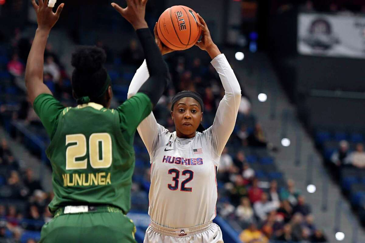 Connecticut's Batouly Camara (32) is guarded by South Florida's Bethy Mununga in the second half of an NCAA college basketball game, Monday, March 2, 2020, in Hartford, Conn. (AP Photo/Jessica Hill)