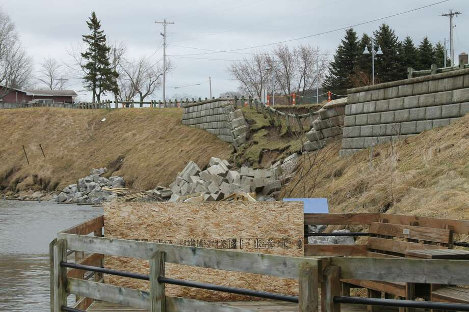 The retaining wall near the parking area on First Street, near Cherry Street, completely crumbled over the weekend. Photo: Michelle Graves/News Advocate