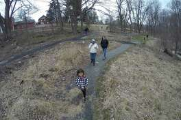 Teegan McCarrel, 4 of Pelham, New York, leads the way as she and her family take a nature walk on the trails of the Greenwich Audubon Center on March 28, 2020 in Greenwich, Connecticut. Teegan and her younger brother Casy have been couped up for two weeks with their parents, while self isolating at their home. So the family decided to take a quick trip to visit grandma, Greenwich resident Janet Zibelli, take in the trails and get some fresh air.