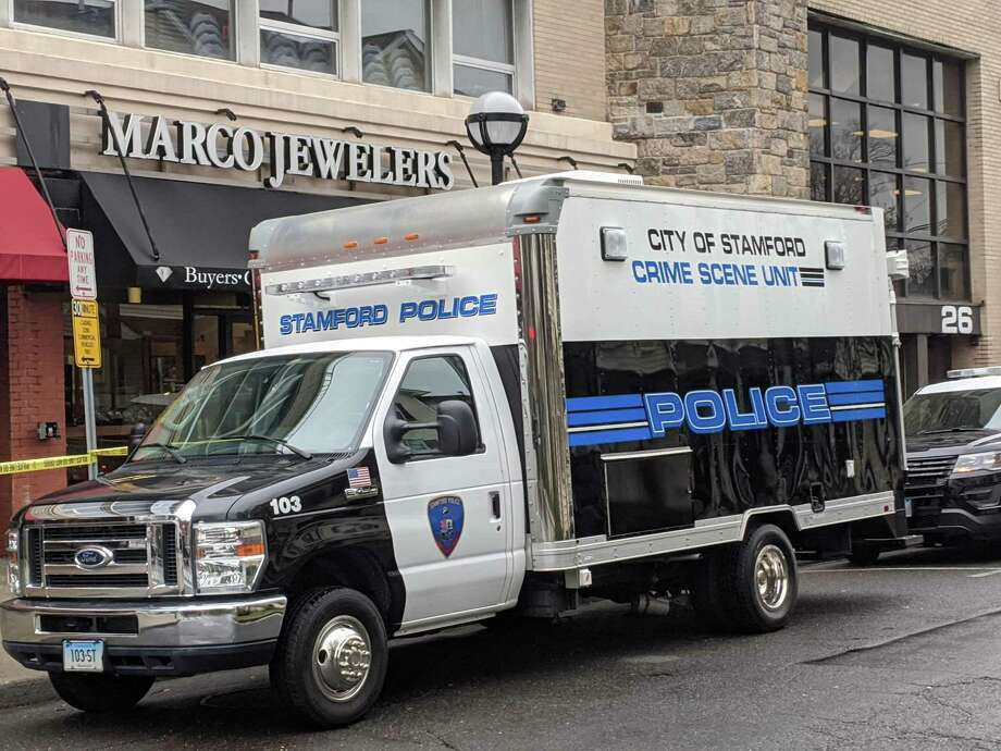 Stamford police vehicles are parked outside Marco Jewelers on 6th Street Sunday afternoon. Police say the owner of the store was shot and killed during an afternoon robbery on Saturday. Photo: Ken Borsuk / Hearst Connecticut Media
