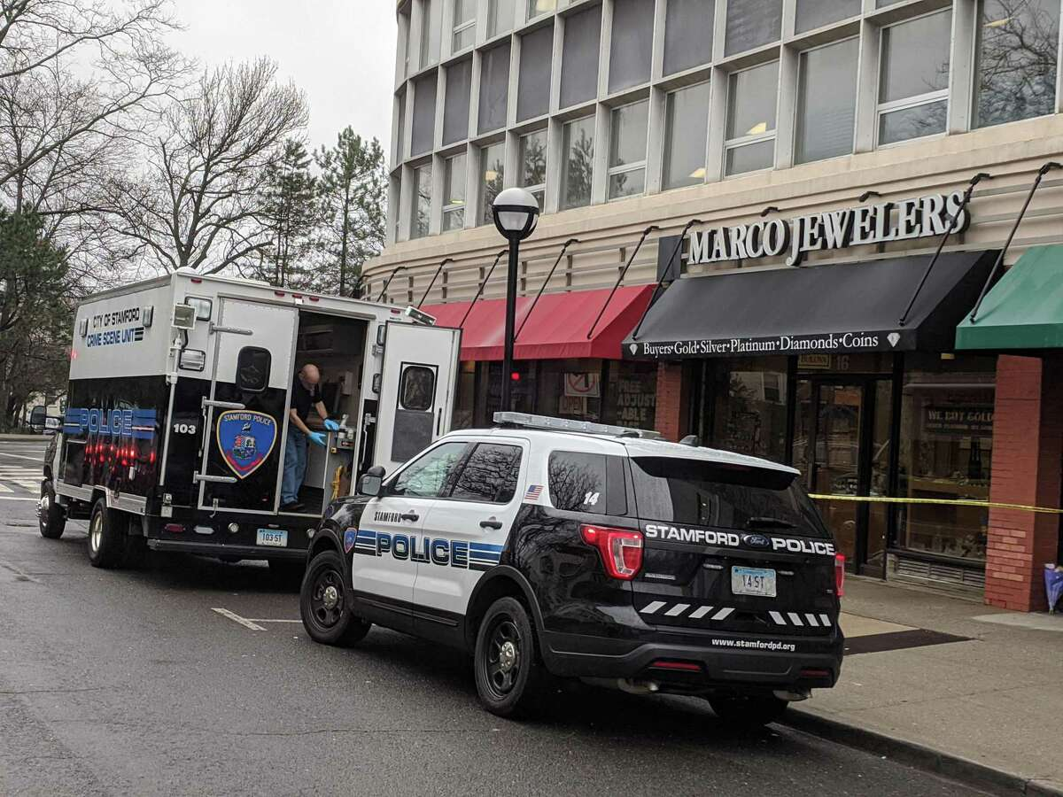Stamford police work outside Marco Jewelers on 6th Street Sunday afternoon. Police say the owner of the store was shot and killed during an afternoon robbery on Saturday.