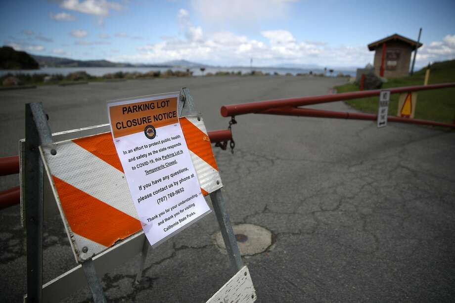 A sign announces the closure of a parking lot at China Camp State Park in San Rafael as part of Gov. Gavin Newsom's shutdown to prevent crowds and stop the spread of the coronavirus. Photo: Justin Sullivan / Getty Images