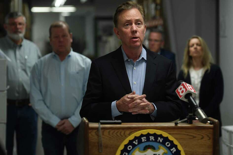 Governor Ned Lamont addresses the media at medical equipment manufacturer Bio-Med Devices in Guilford, Conn. on Sunday, March 29, 2020. The company has signed a contract to produce ventilators for the state at an initial quantity of ten per week for ten weeks.