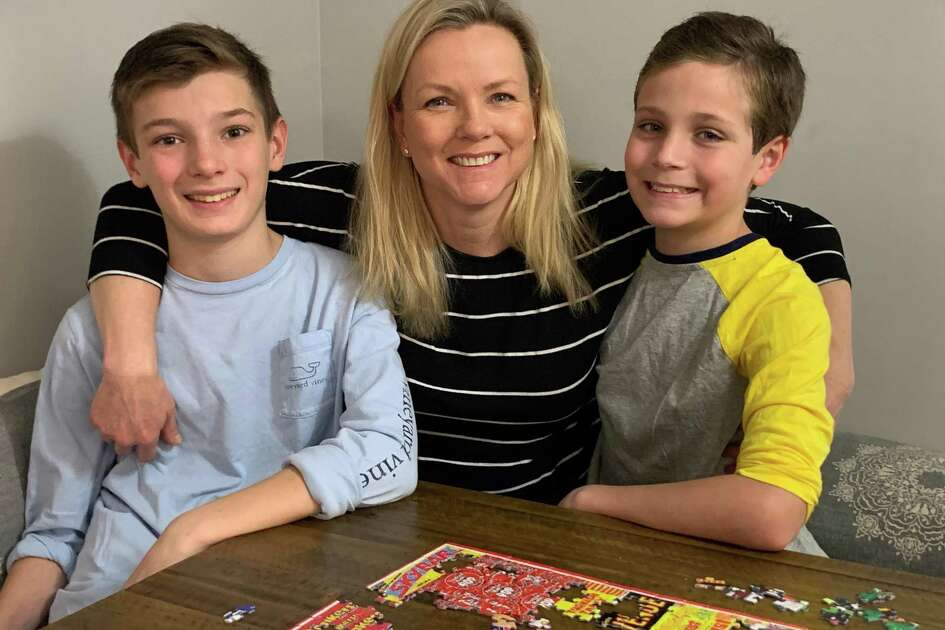 Darien resident Kristina Gregory with her sons, Peter, left, 13, and Nathan, 11. Gregory has been recovering from COVID-19. She was separated from her family for over a week quarantined in her room at home.