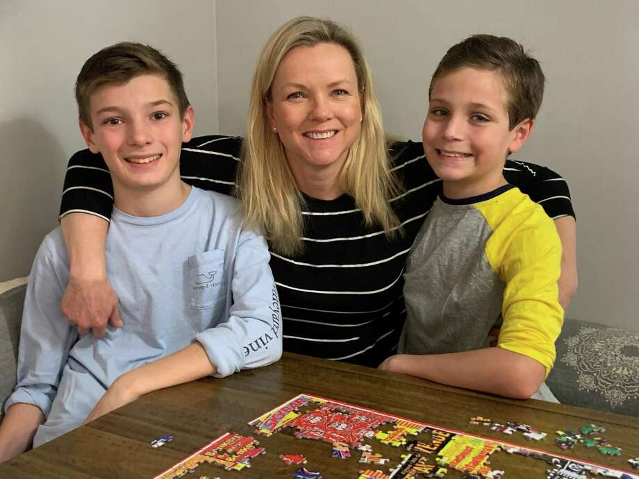 Darien resident Kristina Gregory with her sons, Peter, left, 13, and Nathan, 11, in March as she was still recovering from COVID-19. Photo: Contributed /