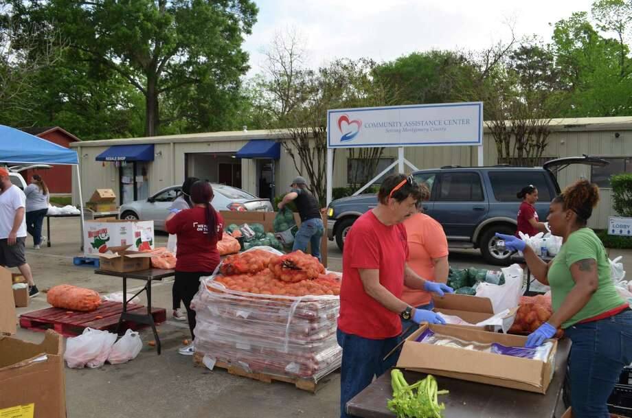 The Community Assistance Center in Conroe is moving its Wednesday Markets to The Ark Church. On March 25, the CAC helped over 350 county families with groceries at its drive-through food distribution. Photo: Provided