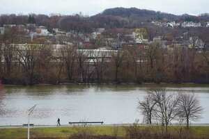 A man walks along the bike path through the Corning Preserve along the Hudson River on Sunday, March 29, 2020, in Albany, N.Y.  (Paul Buckowski/Times Union)