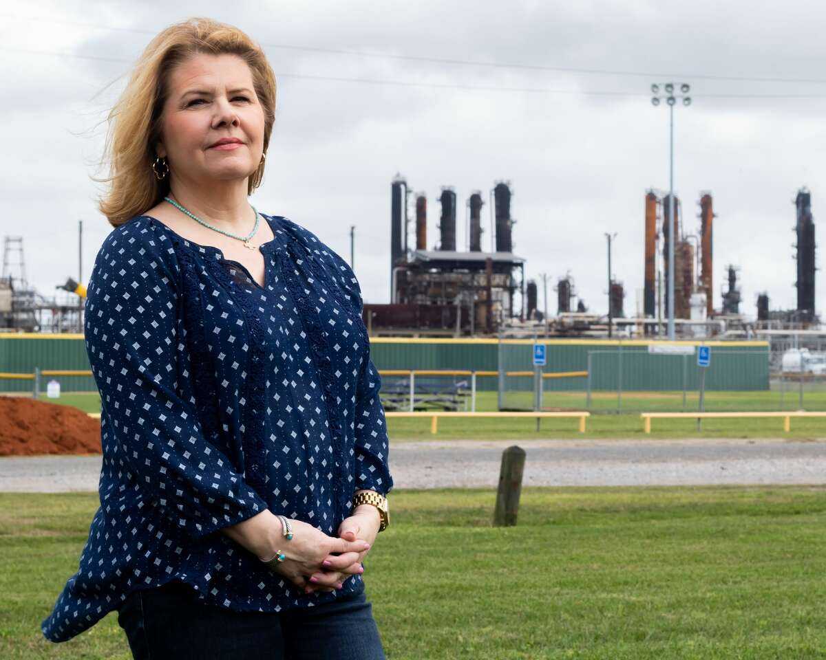 Suzanne Williamson stands in the playground outside the Port Neches Library with the TPC Group plant that had an explosion and fire in November in the background. Photo made on March 12, 2020. Fran Ruchalski/The Enterprise