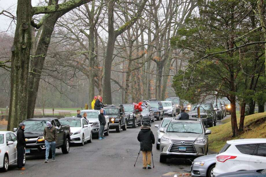 Cars line the driveway through Mead Park in New Canaan on Sunday, March 29, 2020, as residents turned out to welcome home Riley Grise from her open heart surgery in New York City, while keeping safe distance to slow the spread of the coronavirus. Photo: Terry Dinan / For Hearst Connecticut Media / New Canaan Advertiser