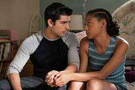 "This image released by Netflix shows Diego Tinoco, left, and Sierra Capri in a scene from ""On My Block."" The series is an honest portrayal of the realities young adults face growing up in inner-city Los Angeles, and critics have praised the comedy-drama's depiction of four bright, street-savvy friends with nuance and care. (Kevin Estrada/Netfli via AP)"