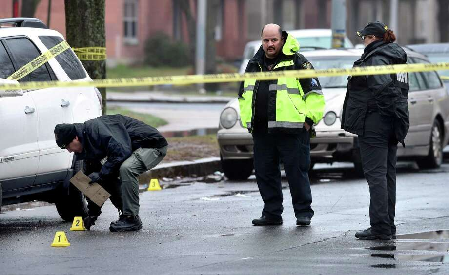 New Haven Police investigate a crime scene on Level Street in New Haven on March 29, 2020. Photo: Arnold Gold / Hearst Connecticut Media / New Haven Register