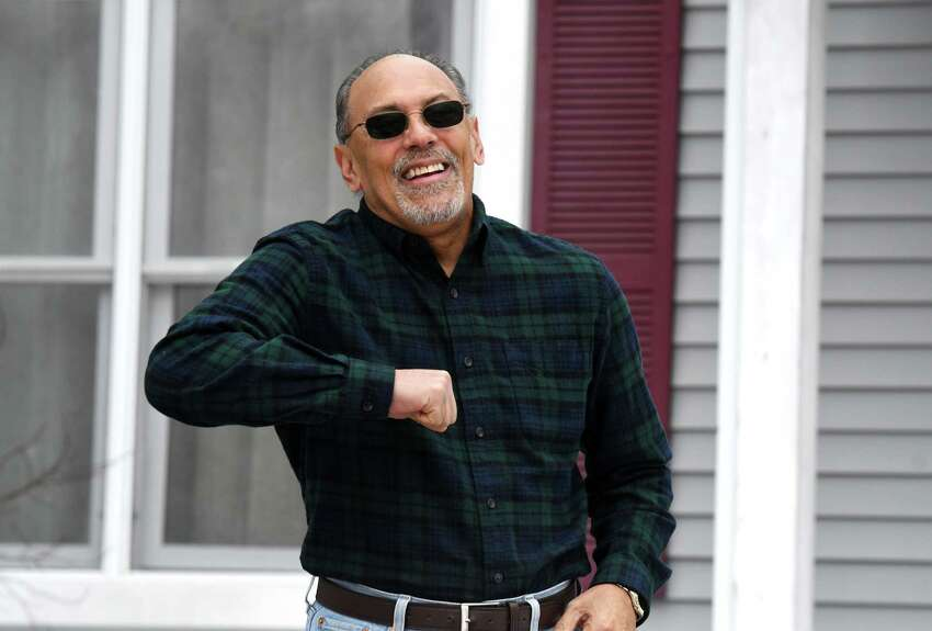 Pedro Diaz demonstrates an elbow bump greeting, which has become popular during the coronavirus epidemic, on Wednesday, March 25, 2020, outside his home in Rensselaer, N.Y. (Will Waldron/Times Union)