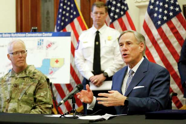 Texas Gov. Greg Abbott announces the U.S. Army Corps of Engineers and the state are putting up a 250-bed field hospital at the Kay Bailey Hutchison Convention Center in downtown Dallas during a news conference at the Capitol in Austin on Sunday. (Tom Fox/The Dallas Morning News via AP, Pool)