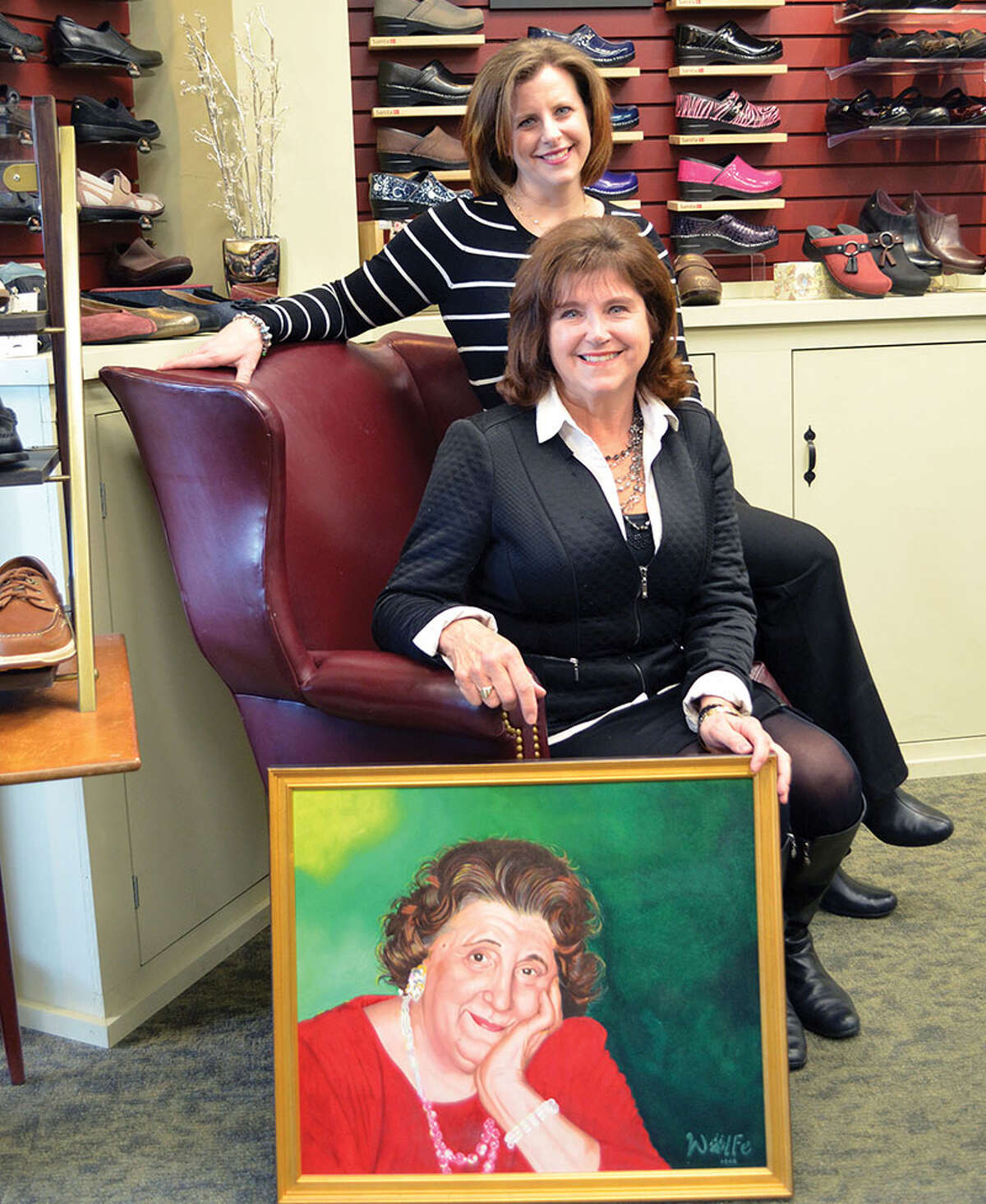 Three generations of the Leonardo family have combined to make Delmar Bootery a small business success story: Pictured are Mandy Sundling-Young, Gail Leonardo Sundling with a portrait of Gail's mom Jessie Leonardo. (Provided)