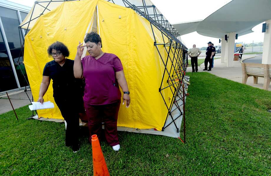 Medical personnel check out one of their tent facilities after representatives from multiple Southeast Texas counties annnounced the opening of a drive-thru testing unit for COVID-19 at Jack Brooks Regional Airport Monday. Photo taken Monday, March 23, 2020 Kim Brent/The Enterprise Photo: Kim Brent/The Enterprise