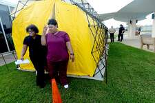 Medical personnel check out one of their tent facilities after representatives from multiple Southeast Texas counties annnounced the opening of a drive-thru testing unit for COVID-19 at Jack Brooks Regional Airport Monday. Photo taken Monday, March 23, 2020 Kim Brent/The Enterprise