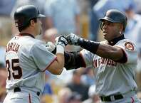 San Francisco Giants home run king Barry Bonds, right, is congratulated by teammate Rich Aurilia after hitting a three-run home run off Los Angeles Dodgers pitcher Kevin Brown for his first home run of the season during the second inning of their season opener at Dodger Stadium, Tuesday, April 2, 2002, in Los Angeles. Aurilia scored on the home run. (AP Photo/Kevork Djansezian)