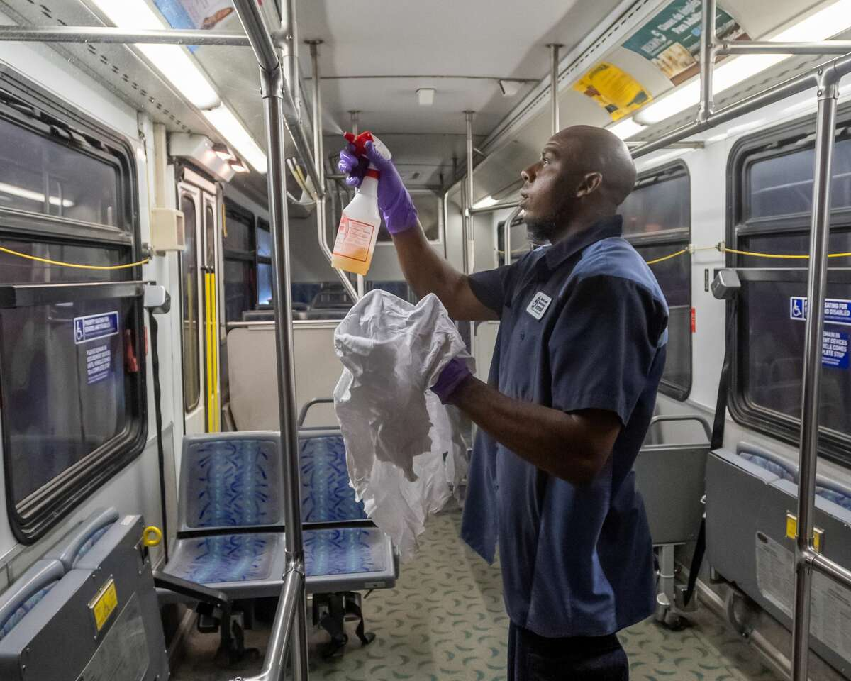 Beaumont Municipal Transit employee Keith Hamilton sprays a cleaning solution on all of the hand rails of a transit bus in the cleaning process on March 25. 2020. The crew members have adjusted their nightly routine to more thoroughly clean and sanitize the buses at the depot each night. Fran Ruchalski/The Enterprise