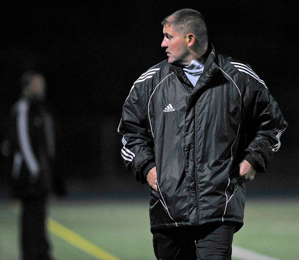Former Newtown coach Brian Neumeyer looks back at his bench during a game against Bethel in 2016. Neumeyer is the new coach at Fairfield Prep.