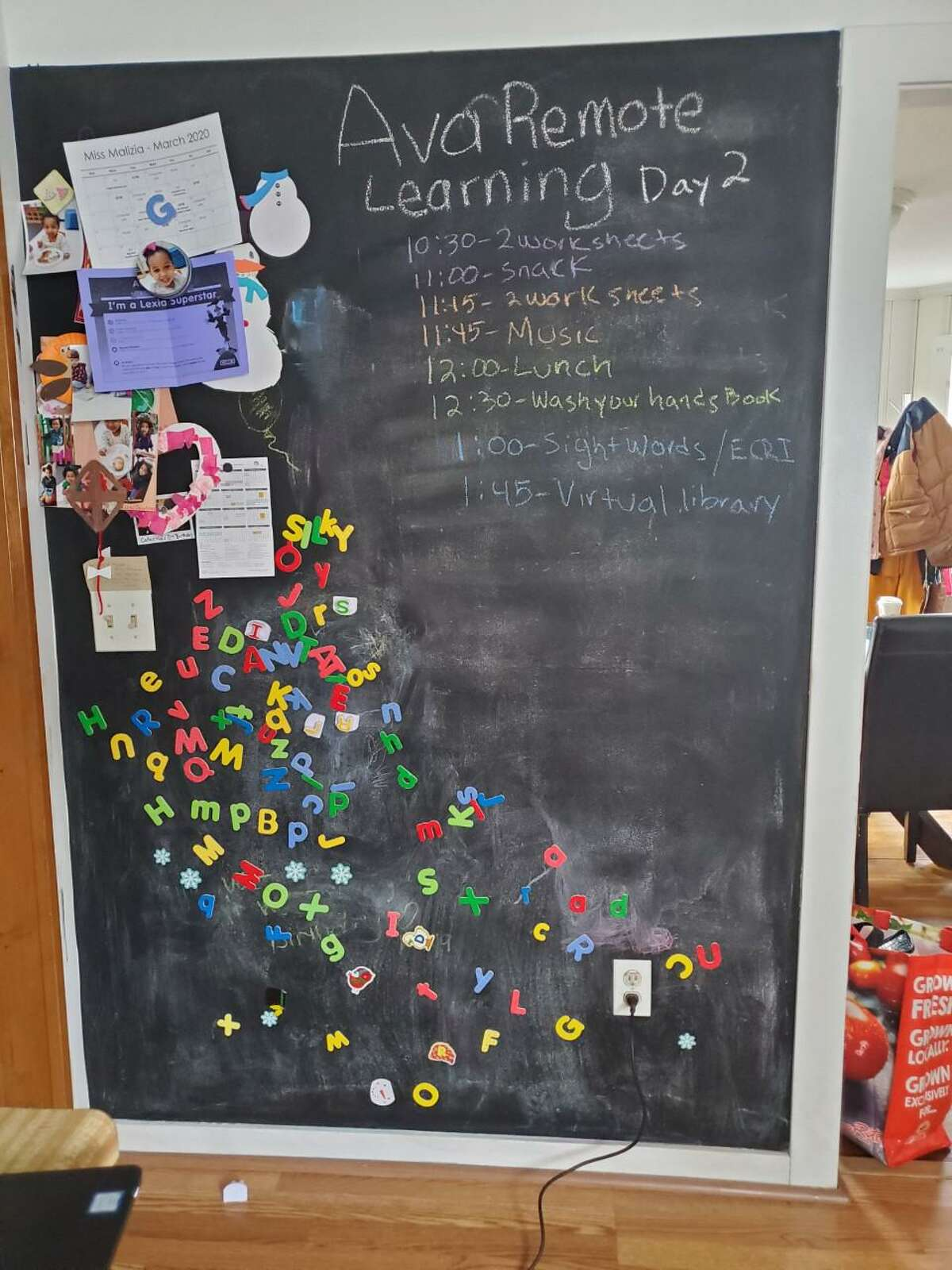 One Norwalk family created a plan for the day on their home blackboard.