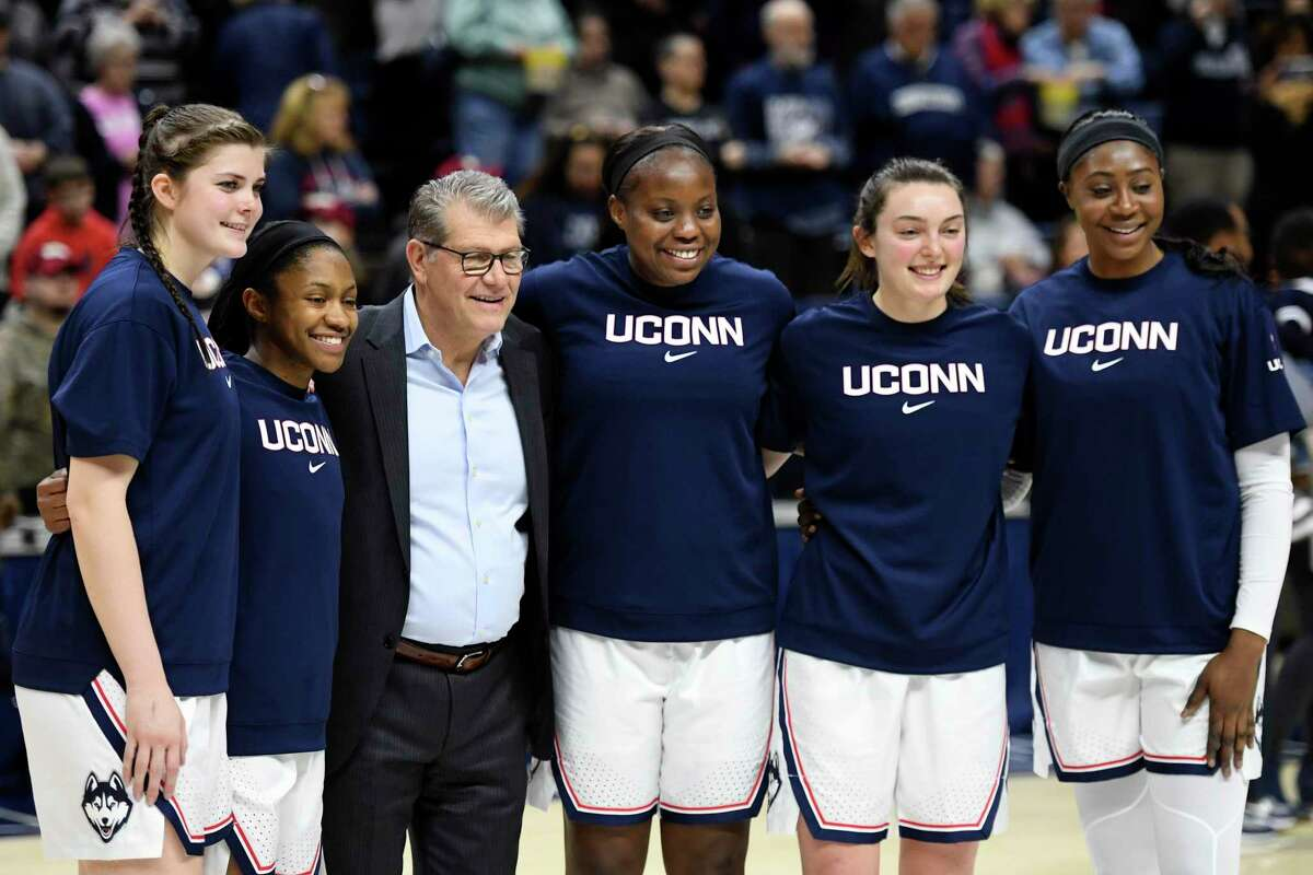 Joining UConn head coach Geno Auriemma were seniors honored before the game against UCF Saturday, Feb. 22, 2020 in Storrs. Left to right: Kyla Irwin (25), Crystal Dangerfield (5), Evelyn Adebayo (14), Molly Bent (10), Batouly Camara (32).