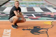 """Luke McClellan poses for a portrait at his painted parking spot at Splendora High School, Thursday, March 26, 2020, in Splendora. """"I can't say I'm stressed about this whole situation. It saddens me to know that we might not get to do some fun things we have looked forward to all these years, but I know there are people in much worse situations right now. I hope to still have a graduation maybe even prom. But all in all, we'll be ok. It will be a class to remember!"""""""