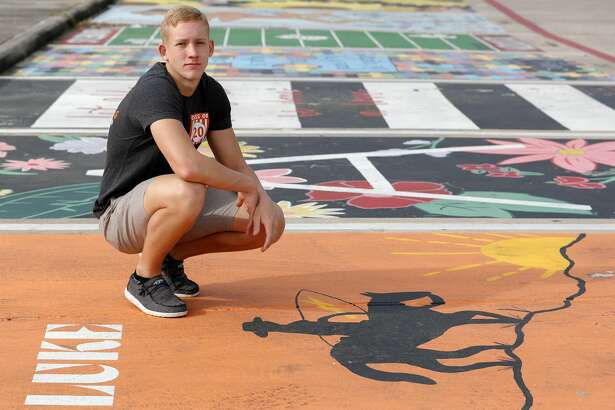 "Luke McClellan poses for a portrait at his painted parking spot at Splendora High School, Thursday, March 26, 2020, in Splendora. ""I can't say I'm stressed about this whole situation. It saddens me to know that we might not get to do some fun things we have looked forward to all these years, but I know there are people in much worse situations right now. I hope to still have a graduation maybe even prom. But all in all, we'll be ok. It will be a class to remember!"""