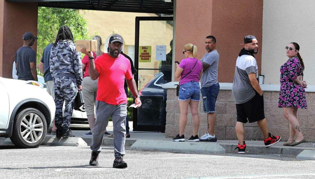 A gun owner left a Florida gun shop last week, as gun sales have increased nationwide in response to the coronavirus pandemic. Gov. Ned Lamont recently ordered Connecticut gun stores to limit operations to appointment-only to discourage crowds.