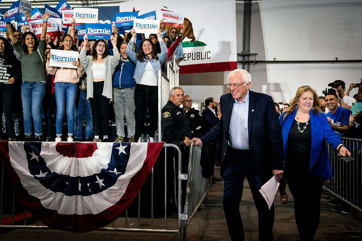 Bernie Sanders and his wife, Jane O'Meara Sanders, arrive at a campaign rally in San Jose, Calif., on Sunday, March 1, 2020. on March 1, 2020. Latino voters in California, Texas and around the country are invested in picking someone who can beat President Doanld Trump, though they don't all agree on who that is. (Erin Schaff/The New York Times)