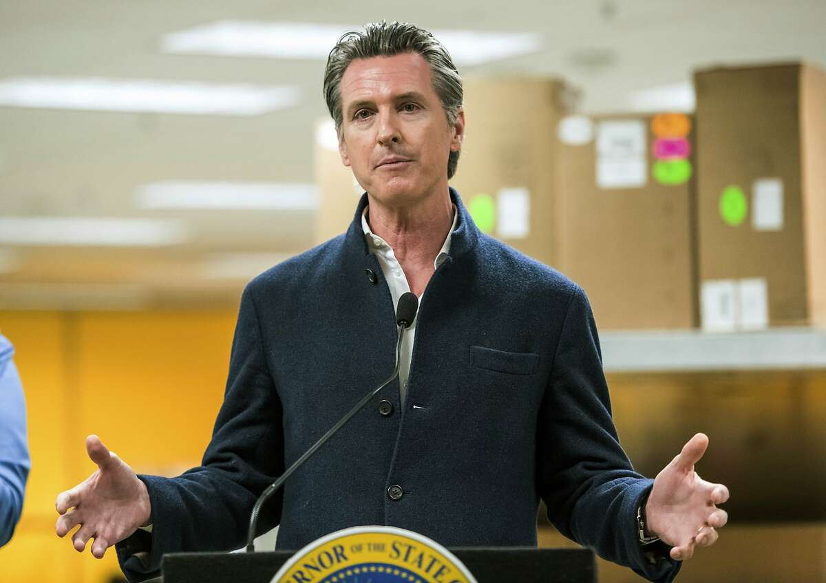California Gov. Gavin Newsom speaks during a news conference at the Bloom Energy campus in Sunnyvale, Calif., Saturday, March 28, 2020. Bloom Energy is a fuel cell generator company that has switched over to refurbishing ventilators as an increasing number of patients experience respiratory issues as a result of COVID-19, caused by the new coronavirus. (Beth LaBerge/KQED via AP, Pool)