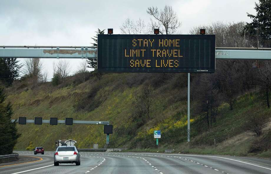 A sign on Interstate 5 encourages social distancing in Seattle, March 24, 2020. After emerging earlier this month as the first coronavirus hotspot in the U.S., including 37 of the nation�s first 50 reported deaths, the Seattle area now has growing evidence that the region�s containment strategies are paying off - at least for now. (Ruth Fremson/The New York Times) Photo: Ruth Fremson, NYT