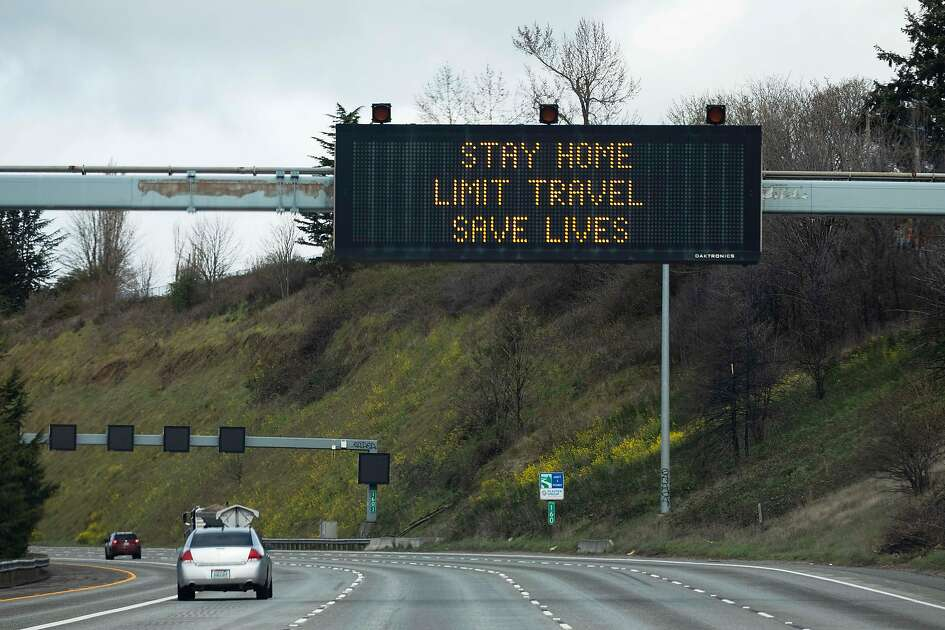 A sign on Interstate 5 encourages social distancing in Seattle, March 24, 2020. After emerging earlier this month as the first coronavirus hotspot in the U.S., including 37 of the nation�s first 50 reported deaths, the Seattle area now has growing evidence that the region�s containment strategies are paying off - at least for now. (Ruth Fremson/The New York Times)