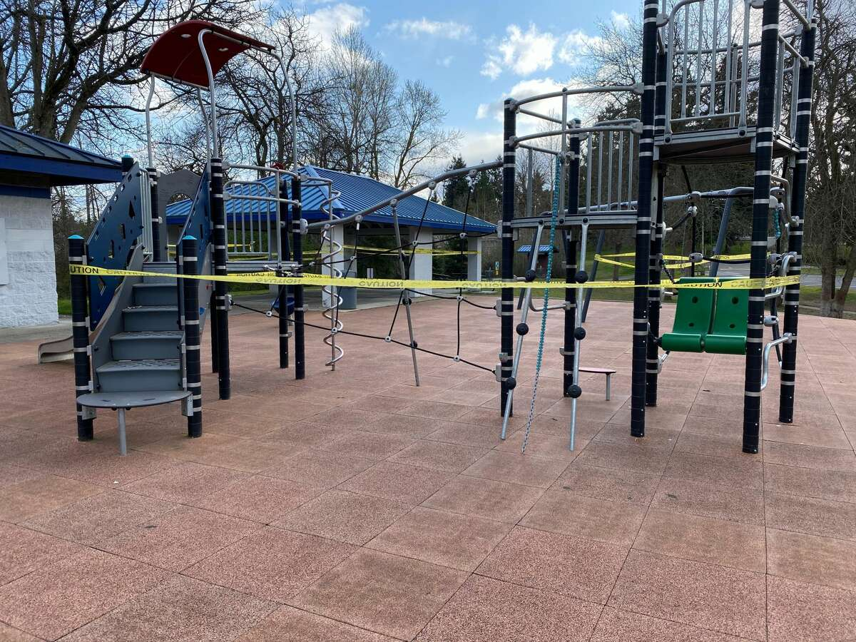 A playground at Hicks Lake in Burien, Wash. is closed off with caution tape on March 29, 2020. Gov. Inslee's