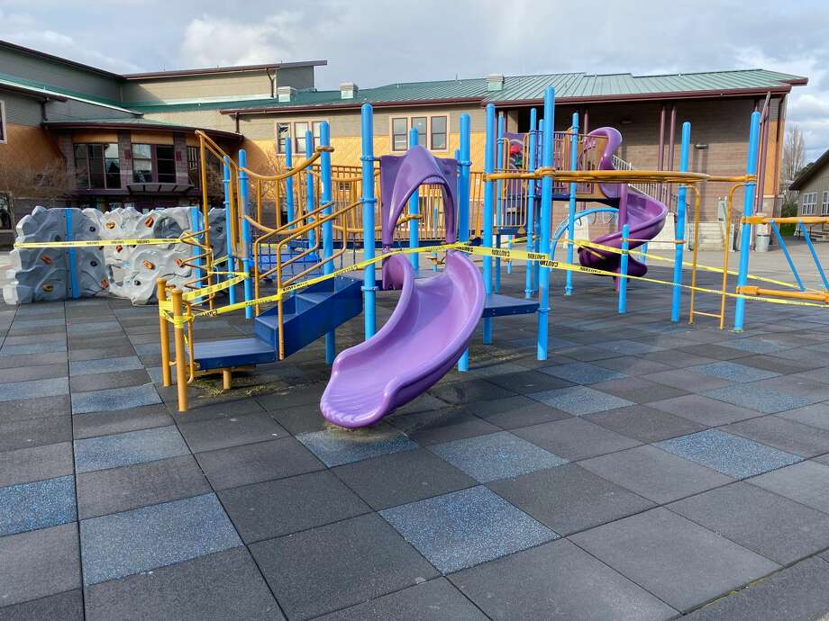 """A playground in White Center, Wash. is closed off with caution tape on March 29, 2020. Gov. Inslee's """"Stay Home, Stay Healthy"""" order includes the closure of all King County parks and playgrounds. Photo: Kristina Moy"""