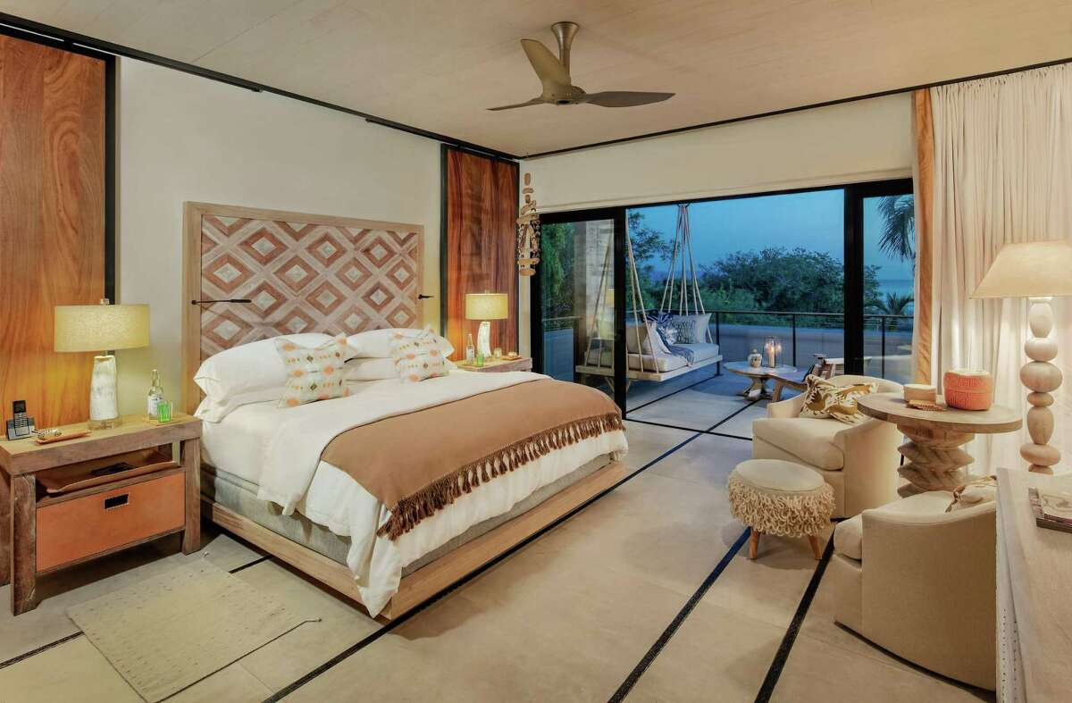 Sliding glass doors off the owner's suite will open to a terrace with a porch swing and ocean views.