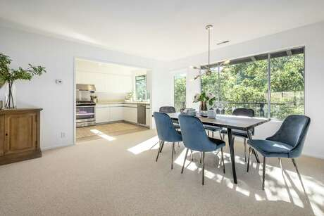 Stager Margot Oven, principal of Marin County's MO Design, emphasizes the use of natural materials when staging. The dining area of this Larkspur home features leather chairs and a hardwood table.