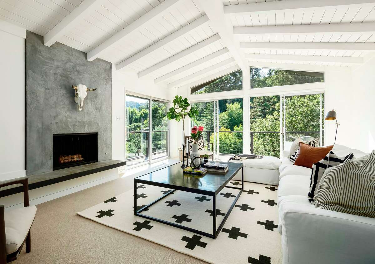 Stager Margot Oven, principal of Marin County's MO Design, said it's important to stage a room with quality pieces of furniture and add flourishes with pillows, area rugs and floral arrangements.